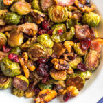 These roasted balsamic Brussels sprouts are absolutely delicious. Baked with dried cranberries, bacon and walnuts, they are a healthy, Whole30 side dish everyone will love. They're also paleo, gluten-free and low carb, and a really easy and tasty way to get vegetables on the table. With only 5 ingredients and 30 minutes, this is sure to be your go-to method for cooking brussels sprouts! #whole30vegetables #brusselssproutsrecipes #roastedbrusselssprouts #paleovegetables #baconrecipes #easyvegetablerecipes