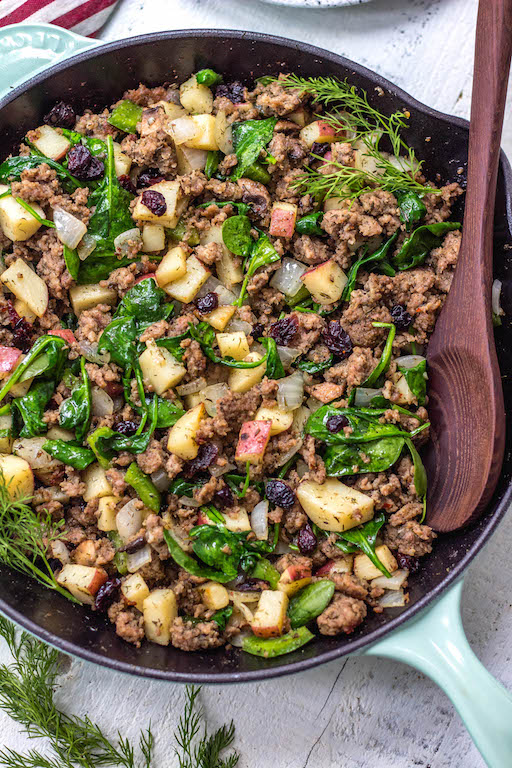 This Whole30 sausage and cranberry breakfast skillet is a quick and easy, family friendly, egg-free breakfast. A Paleo, gluten-free recipe that's filling, full of flavor, and perfect for meal prep. One pan meals are the way to go for fast meal prepping, and this Whole30 breakfast is the perfect addition to your menu for during the week. #whole30eggfree #eggfreebreakfast #whole30breakfastskillet #whole30breakfast #paleobreakfast