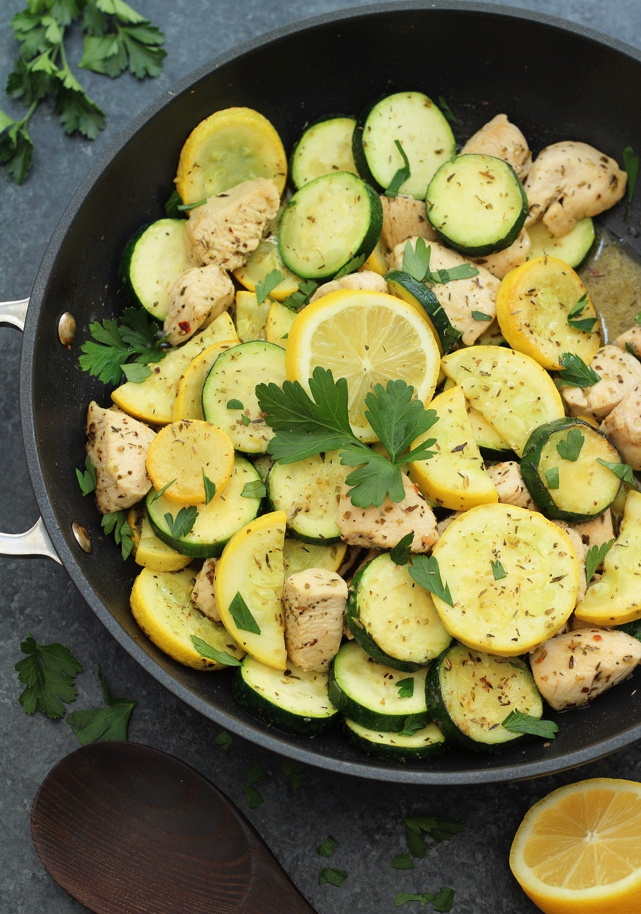 This Whole30 lemon chicken and squash skillet is Paleo, under 30 minutes, low carb and only made in one pot. This is a perfect summer dish for meal prep, or for a family friendly weeknight meal you won't have to heat up your kitchen for. #whole30lemonchicken #whole30onepot #paleochickenrecipes #whole30chickenrecipes
