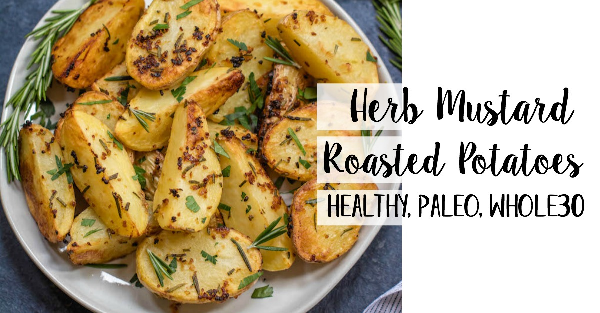 These garlicky, herb and mustard roasted potatoes are baked to crispy perfection. This Whole30 and paleo side dish takes just minutes to throw together for an easy weeknight dinner and are delicious enough to be a crowd pleaser at any holiday meal. The potato side dish requires only a handful of simple ingredients, 30 minutes in the oven and reheats great for leftovers or breakfast #whole30sidedish #whole30potatoes #paleosidedish #mustardpotatoes