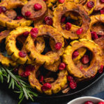 This roasted delicata squash, sweet potato and cranberry recipe is an easy, healthy side dish that has all of the best seasonal fall flavors. Made with real ingredients, it's a simple gluten-free, paleo and Whole30 Thanksgiving or holiday vegetable dish that makes a beautiful statement on the table. #whole30sidedish #delicatasquash #whole30vegetables #whole30holidayrecipes #holidayvegetables
