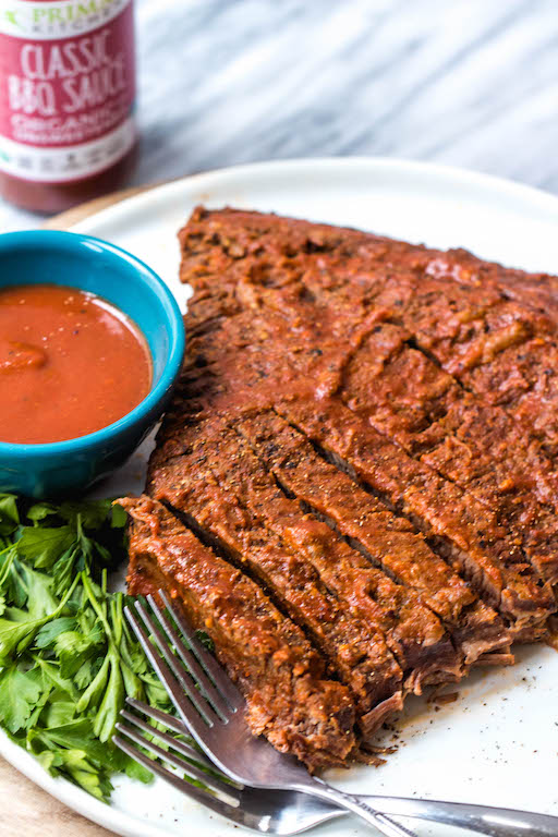 This easy BBQ beef brisket is so simple thanks to help from the instant pot, and it's perfect for an easy weeknight dinner. With the BBQ sauce and only a handful of other ingredients, the Whole30 and Paleo brisket has a classic smoky flavor that the whole family will love. #whole30beef #paleobeef #instantpotbeef #whole30instantpot