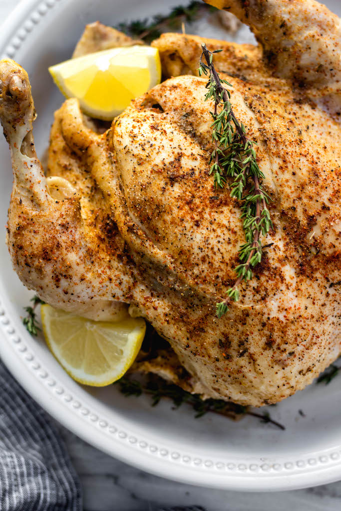 This Whole30 instant pot whole chicken is one of the easiest ways to get a healthy, paleo dinner on the table or meal prep done quickly. With the lemon and spices, it's a full-of-flavor, juicy and uncomplicated paleo, keto or Whole30 chicken recipe. Plus, the options for the leftover chicken is endless! #whole30 #wholechicken #instantpotwholechicken #paleo #keto #chickenrecipes
