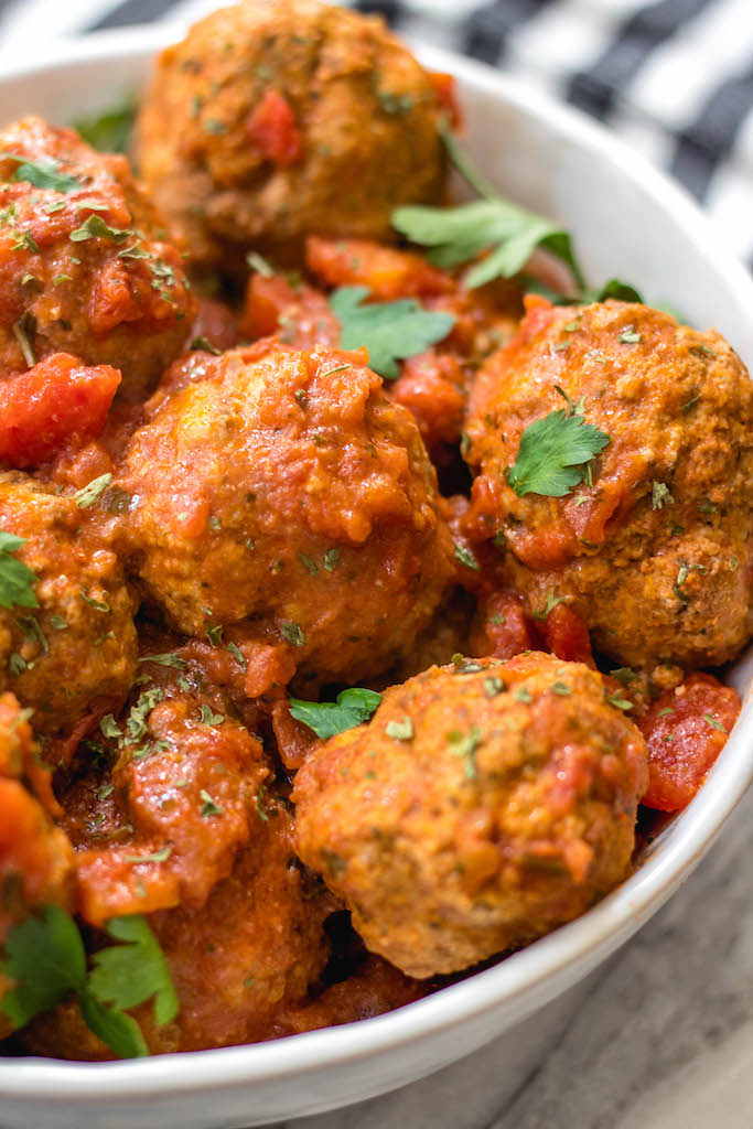 These instant pot beef meatballs are Whole30, paleo, gluten-free and, importantly, so easy to make. The meatballs and marinara take less than 10 minutes cooking time with the pressure cooker and they're a great family friendly healthy recipe for a weeknight dinner or for a Whole30 meal prep recipe. #whole30beefmeatballs #whole30instantpot #whole30beefrecipes #paleoinstantpot #paleomeatballs #ketoinstantpotrecipes