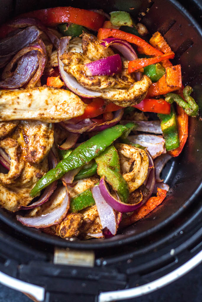 Whole30 air fryer chicken fajitas are perfect for a quick but healthy weeknight meal. These paleo fajitas can be on the table in under 30 minutes and are also gluten-free, keto, and definitely whole family approved. Eat right away or meal prep for the next day but either way they'll be delicious. #whole30airfryer #paleoairfryer #ketoairfryer #chickenairfryer #glutenfreeairfryer #airfryerchicken
