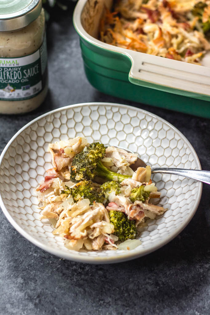 This creamy chicken and bacon alfredo casserole is loaded with veggies from the hash browns and broccoli, and it's paleo, Whole30 compliant, dairy free and gluten free. With only 7 ingredients, it really couldn't be easier to make for a quick weeknight meal or for a simple meal prep recipe. #whole30casserole #whole30chickenrecipes #whole30chickencasserole #paleocasserole #paleochickenrecipes #dairyfreecasserole