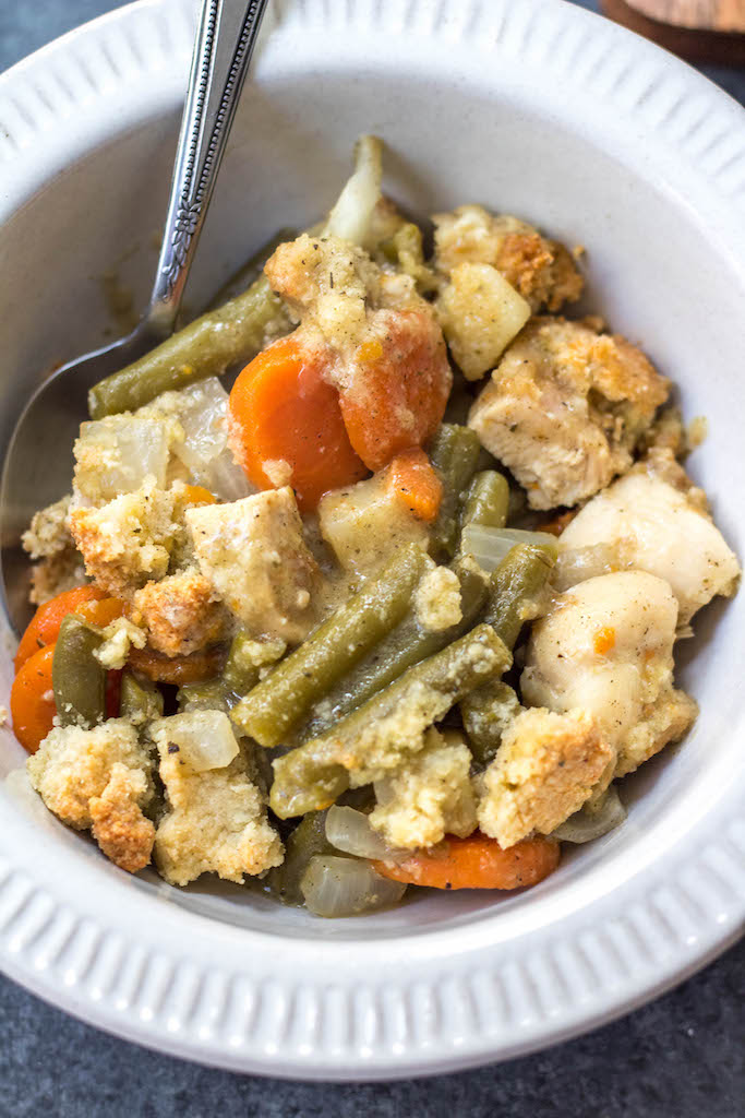This Whole30 chicken pot pie casserole is the the perfect Whole30 casserole recipe when you're wanting something hearty and comforting. It's a paleo and dairy free twist on the classic pot pie flavors you know and love with a grain free crust, and is awesome for a weeknight meal or for a paleo meal prep recipe because it reheats so well. This is a great family friendly recipe that is sure to become a staple! #whole30casserole #paleocasserole #whole30chickenpotpie #whole30chickenrecipes #paleochickenrecipes