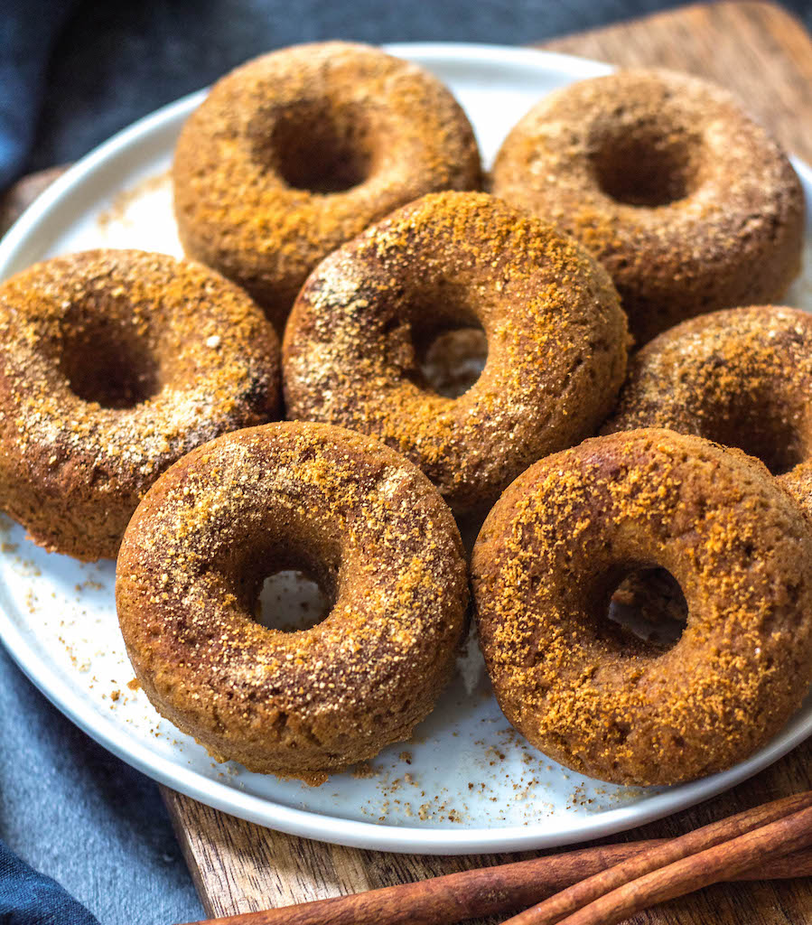 This easy homemade paleo pumpkin donut recipe makes 12 perfect, gluten free and grain free pumpkin spiced donuts. They're the best paleo fall treat that only take a few simple pantry ingredients and a few minutes in the oven. Using real pumpkin, and no refined sugar, these are a much healthier alternative to store-bought pumpkin donuts, and one that the whole family will love! #paleopumpkindonuts #paleodonuts #paleopumpkinrecipes #grainfreedonuts #glutenfreepumpkinrecipes