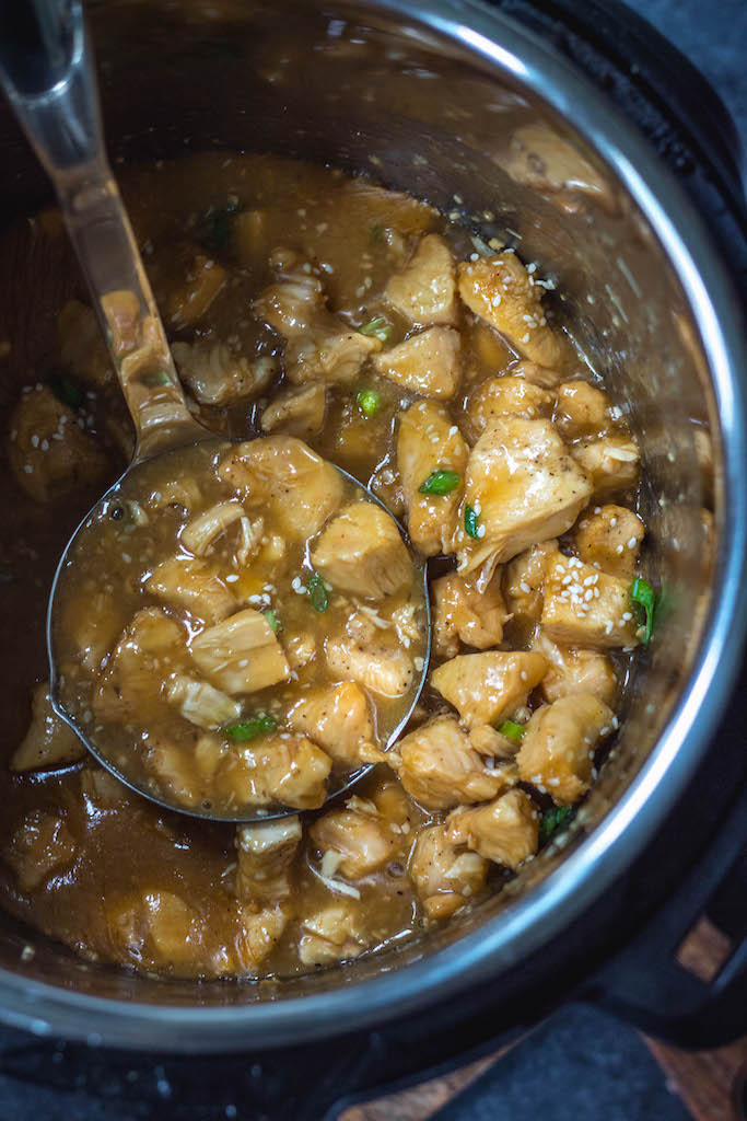 This Whole30 instant pot sesame chicken recipe is the easy button when it comes to making a healthy weeknight dinner. It's paleo, gluten free, dairy free, and only has a 15 minute cook time. This quick take out fake out sesame chicken will be a family favorite, or a perfect meal prep recipe! #whole30instantpot #paleoinstantpot #whole30sesamechicken #paleosesamechicken #instantpotsesamechicken