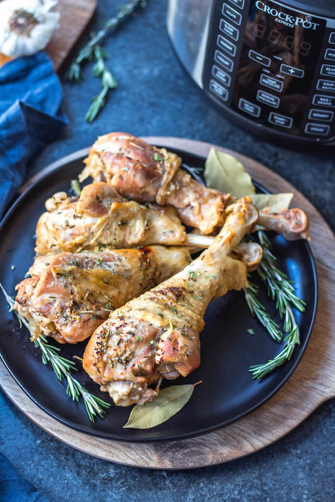 These easy pressure cooker herbed turkey legs are an easy Thanksgiving addition or perfect for just a simple weeknight meal. They're paleo, Whole30, keto, gluten-free and only take 30 minutes! The herbed butter used helps make the turkey juicy, tender and full of flavor and the gravy is made all in one pot! #whole30pressurecooker #whole30turkey #paleopressurecooker #ketoturkey #turkeylegrecipes #paleothanksgiving