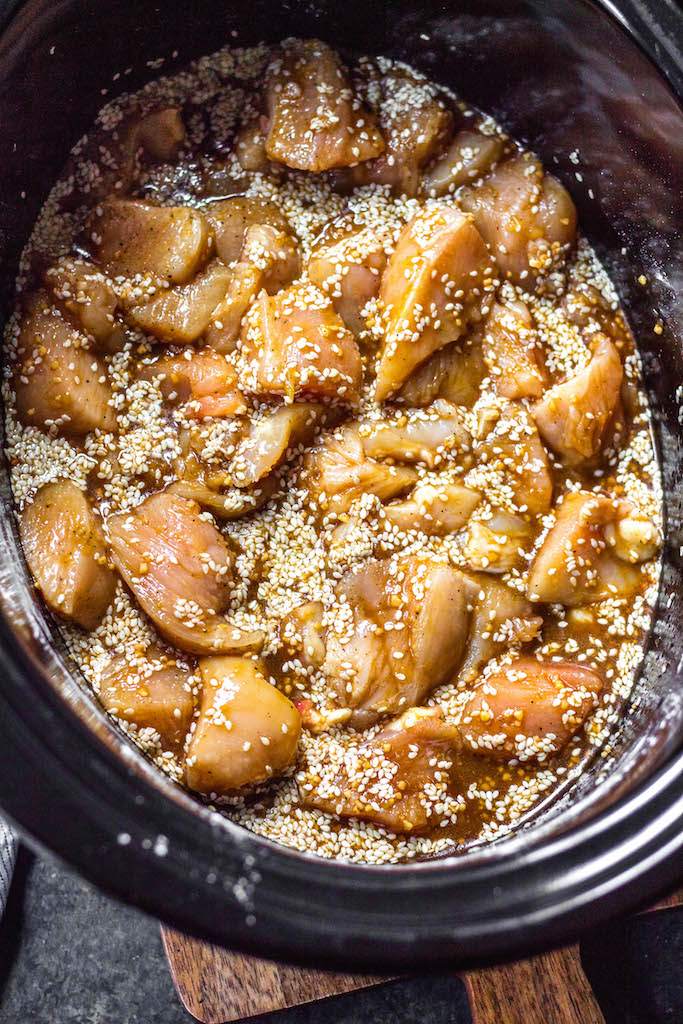 This easy Whole30 slow cooker sesame chicken recipe only calls for a few ingredients and a crock pot, making it an ideal weeknight meal or Whole30 or paleo meal prep recipe. It's so simple yet has such a great take out fake out flavor for when you're craving a healthier Chinese food option. #whole30slowcooker #paleoslowcooker #whole30sesamechicken #whole30chickenrecipes #paleochickenrecipes