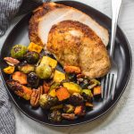 This easy, stress-free oven roasted whole turkey recipe with maple glazed winter vegetables is the perfect addition to any holiday event or family meal. With the maple pecan veggie side dish cooked right at the same time, you can be sure dinner is both simple to make and healthy! #wholeturkey #ovenroastedturkey #thanksgivingrecipes #thanksgivingturkeyrecipes