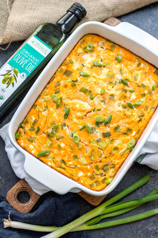 This buffalo chicken egg bake is an easy Whole30, Paleo and Keto breakfast that is quick to prepare, great as leftovers and even freezes well. It only requires a few simple ingredients which makes it a great meal prep recipe. This Whole30 breakfast casserole is also dairy-free, gluten-free and easy to sneak veggies into. #whole30eggbake #whole30breakfast #ketoeggbake #paleoeggbake #buffalochicken