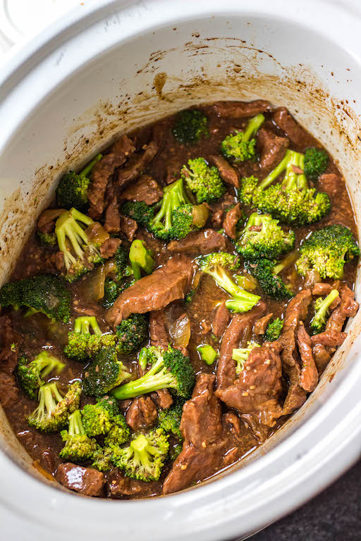 This easy Whole30 slow cooker recipe makes cooking beef and broccoli at home so simple. It comes together in the crock pot incredibly fast, and is a great meal prep recipe or weeknight meal because you just dump the ingredients, and come back later to a healthy, Paleo, keto and Whole30 broccoli beef waiting for you in the slow cooker! #whole30slowcooker #slowcookerbeefandbroccoli #ketoslowcooker #paleoslowcooker #beefandbroccoli