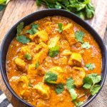 This paleo and Whole30 slow cooker chicken tikka masala recipe is every bit as easy as it is delicious. It's a truly set it and forget it recipe that only requires a few simple ingredients, chicken and a crock pot. The end result is a tasty, healthy and family friendly weeknight dinner or meal for meal prep for the week! It's gluten-free, dairy-free and keto, so it's great for any type of eater in your family! #whole30slowcooker #whole30chickentikkamasala #lowcarbslowcooker #ketoslowcooker #paleochickentikkamasala