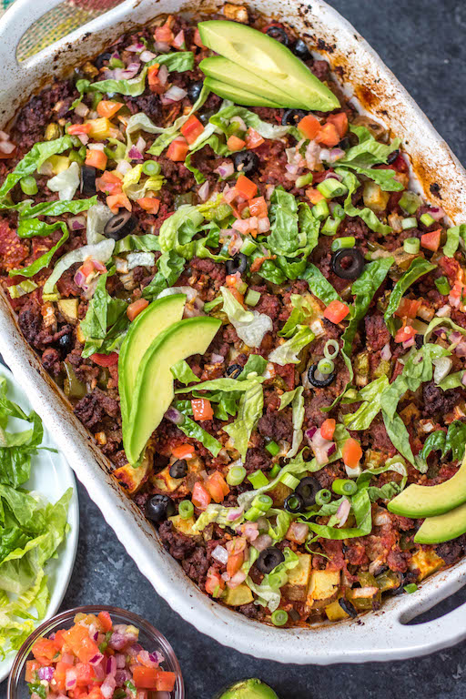 This Whole30 taco casserole is an awesome meal prep recipe or perfect for a paleo or gluten-free weeknight meal. Preparation is simple, just mix everything together, oven bake it, and pull out a delicious beef taco casserole for the family! It's a great way to use up ground beef, and it's healthy recipe option that's loaded with veggies #whole30tacocasserole #whole30casserole #whole30groundbeefrecipes #paleocasserole #paleotacocasserole #glutenfreecasserole