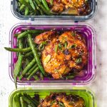This Whole30 Asian chicken thighs and spicy green beans recipe is ideal for a lunch meal prep recipe, or a healthy, paleo weeknight dinner. The sticky Asian marinade is full of flavor and so easy to prepare. With the green bean side, you'll have a low carb and delicious meal in under 30 minutes! #whole30chickenrecipes #whole30mealprep #paleochickenrecipes #paleomealprep #ketochickenrecipes
