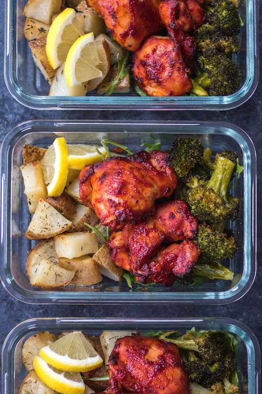 This Whole30 sheet pan BBQ chicken thighs and roasted vegetables recipe is perfect for healthy meal prep, or an easy paleo, gluten-free weeknight dinner. It doesn't get much more simple than only using one pan, having no clean up but ending up with plenty of meal prep for the week that has tons of flavor! #whole30sheetpan #paleosheetpan #whole30mealprep #whole30bbqchicken