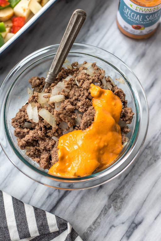 This is a delicious and easy Whole30 ground beef casserole recipe that is a healthy take on a big mac! The classic flavors you know and love, all baked together in a paleo, gluten free Big Mac casserole that's loaded with veggies. It's great for a family friendly weeknight meal, or for meal prep lunches for the week. #whole30casserole #whole30groundbeef #whole30dinnerrecipes #paleogroundbeef #glutenfree