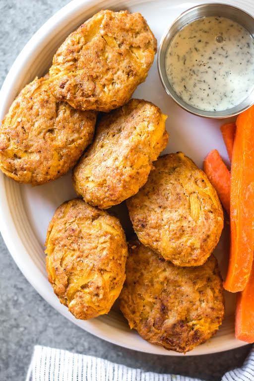 These easy butternut squash chicken nuggets are a healthy, Whole30 and gluten-free alternative to traditional nuggets. This recipe is a great way to sneak vegetables in, and are totally kid and family friendly, and paleo and low carb, too. With only a few ingredients, they're also quick to make for a weeknight meal or meal prep! #whole30recipes #whole30chicken #paleorecipes #paleochickenrecipes #lowcarb #keto #chickennuggets #glutenfreechicken #dinnerrecipes