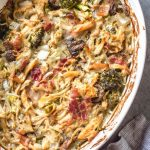 This creamy dijon chicken casserole is an easy and delicious Whole30, Paleo, gluten-free recipe that's great for a weeknight dinner or a simple and healthy meal prep recipe. There's lots of vegetables, bacon and a flavorful dairy-free cream sauce loaded into one casserole dish, and baked to perfection. #whole30recipes #whole30casseroles #paleocasseroles #glutenfreecasseroles #whole30chickenrecipes #easywhole30recipes #mealprep