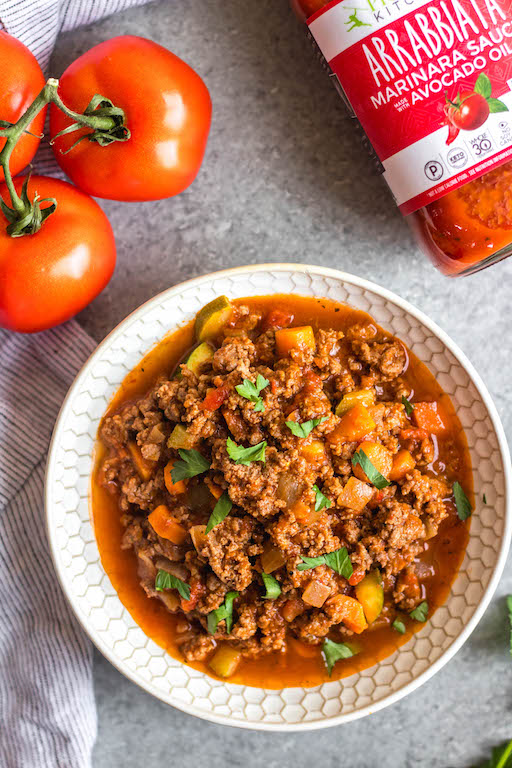 This Whole30 arrabbiata meat sauce with vegetables is made in the instant pot, so everything is cooked in one pot! Made with ground beef and with lots of vegetables snuck in, it's a hearty, cozy and healthy recipe that's great for meal prep. It's also gluten-free, Paleo and low carb/keto. This meat sauce is full of flavor and we love that it's freezer friendly, too. #whole30instantpot #whole30beefrecipes #whole30meatsauce #groundbeefrecipes #paleobeef