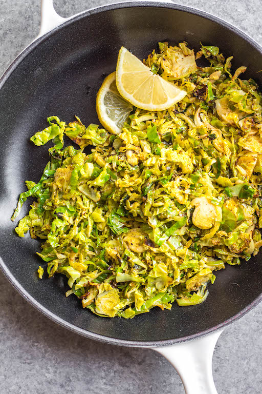 This Whole30 shredded brussels sprouts recipe is the perfect side dish for any breakfast or dinner. They're crispy, sauté really quickly, and only need 3 ingredients. The lemon and garlic flavor pairs well with everything, and keeps the brussels sprouts bright and fresh tasting! These are also low carb/keto, Paleo, gluten-free and just a great way to enjoy your green vegetables! #whole30vegetables #whole30sides #whole30brusselssprouts #ketovegetables #whole30recipes #paleovegetables