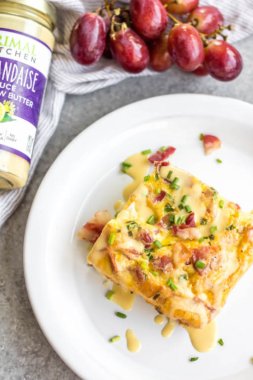 This Eggs Benedict Casserole is a spin on the traditional dish, but with no gluten, grain or dairy! It's a way to enjoy the taste of eggs benedict you love in an egg bake form, which is perfect for meal prep or a family breakfast or brunch. This Whole30 and paleo recipe is easy to whip together and only requires a few minutes of hands on cooking time. #whole30breakfast #whole30eggbake #breakfastcasserole #eggsbenedict #paleobreakfast