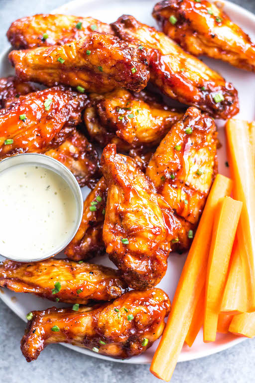 These smoked BBQ wings are easy, don't take very long, and totally delicious! They also only require a few ingredients, and are Whole30, Paleo, gluten-free and keto. Unlike meats when cooked on a smoker, wings are straightforward and not very fussy. These wings are perfectly juicy, have a great smoky flavor and great for any gathering! #whole30chickenwings #smokedchicken #paleochicken #ketochicken #ketosmokerrecipes