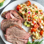 This easy smoked lamb roast is great for entertaining or a special family weekend dinner. It's healthy, quick to prepare and simple to cook on the smoker. It's also Whole30, low carb/keto, gluten-free and paleo, so no matter who's at your dinner table, everyone will enjoy! Seasoned to perfection with spices already in your pantry, this boneless lamb roast is juicy and full of flavor with very little hands on time! #whole30recipes #lambrecipes #smokerrecipes #ketosmoker #paleosmoker #smokedlamb