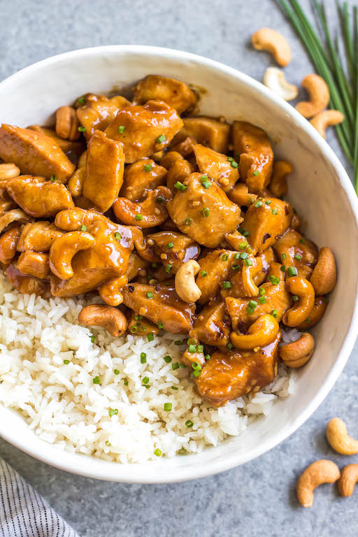 This slow cooker cashew chicken is an easy, healthy dinner or meal prep recipe. It's Whole30, paleo, gluten-free and soy-free, and only needs 10 minutes of prep work to dice chicken and make an easy sauce. The crockpot does the rest of the work, and you get a family friendly meal that's quick and simple to clean up. Paired with a vegetable side, this is the perfect go-to for a busy weeknight! #whole30slowcooker #cashewchicken #whole30chicken #glutenfreechicken #slowcookerrecipes #healthycashewchicken